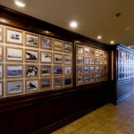wall-of-photos-at-the-proud-bird
